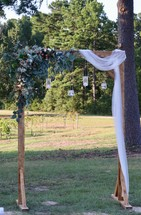 arch at an outdoor wedding
