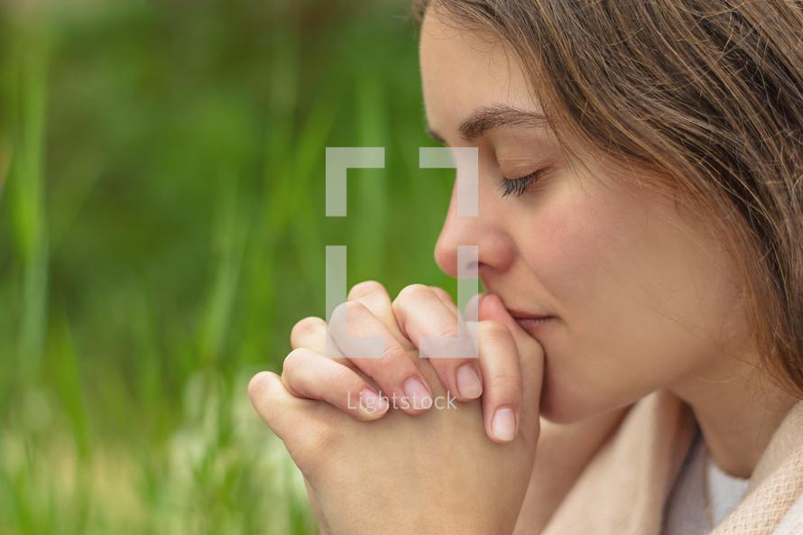 a young woman praying