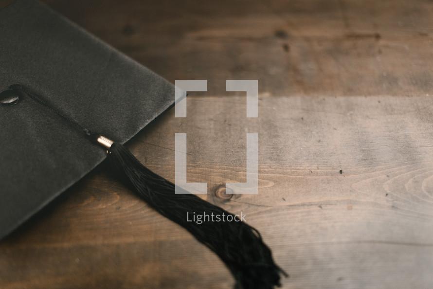 graduation cap on wood