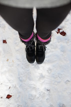 woman's snow boots in the snow