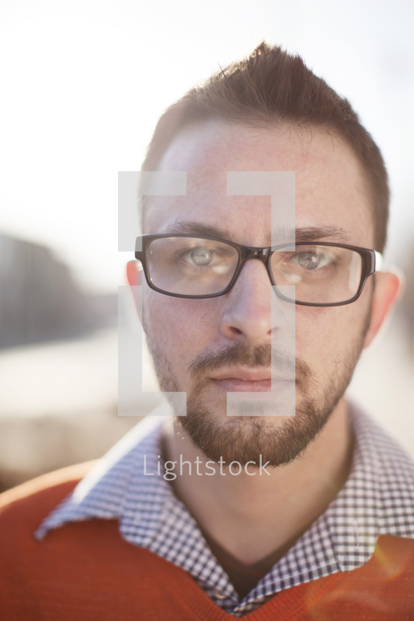 face of a man in reading glasses