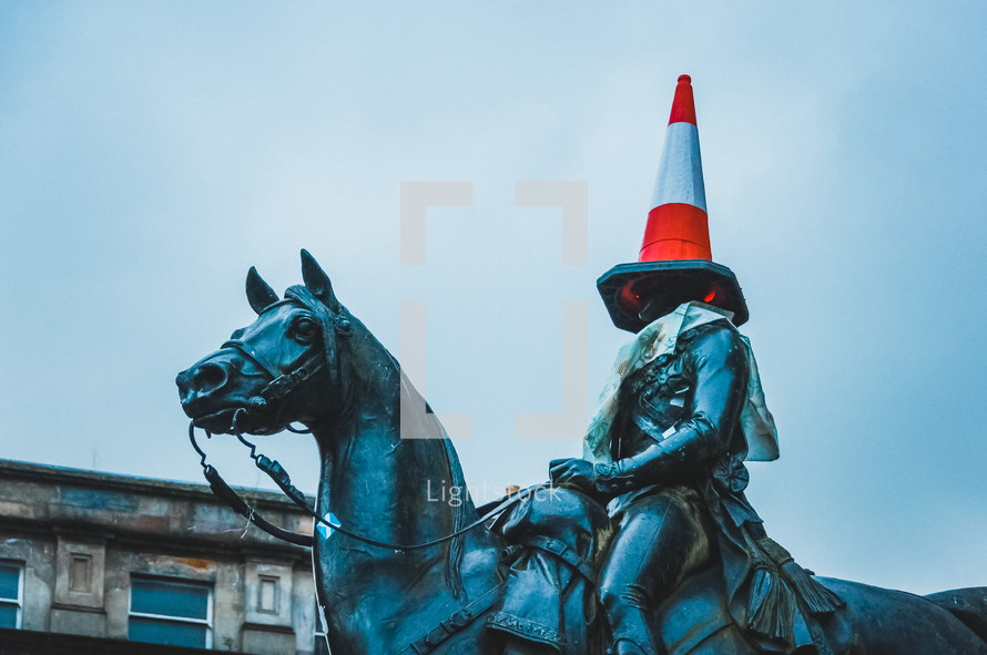 statue with a cone on its head