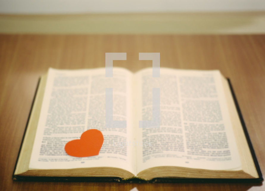 red heart on the pages of a Bible