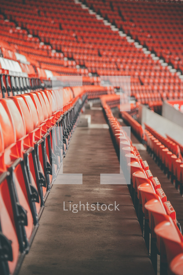 rows of empty seats in a stadium