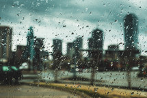 rain on a window and view of a city