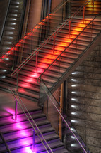 red and purple neon lights on a staircase
