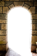 light through an arched doorway