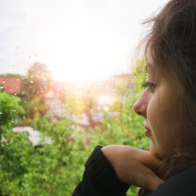 a woman looking out a window