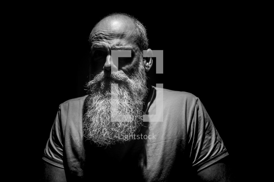 bearded mature man head shot