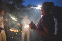 teens around smoke and fireworks at night