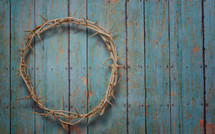 crown of thorns on teal wood background