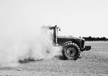 tractor stirring up dust