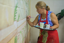 A woman paints at a church in Pennsylvania.