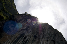 sunburst over the side of a mountain