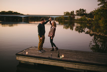 a couple dancing on a dock