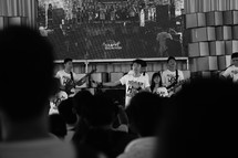 worship leaders on stage playing music