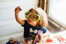 a toddler doing science experiments