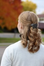 woman with a butterfly barrette in her hair
