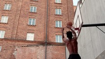 dunking a basketball