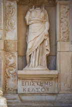 Roman statue and writings