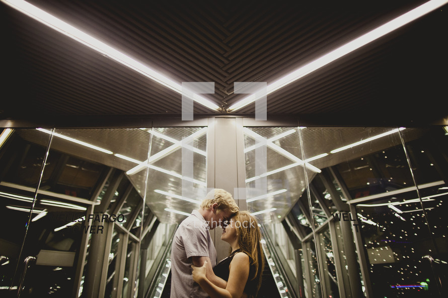 Couple holding each other  inside a building
