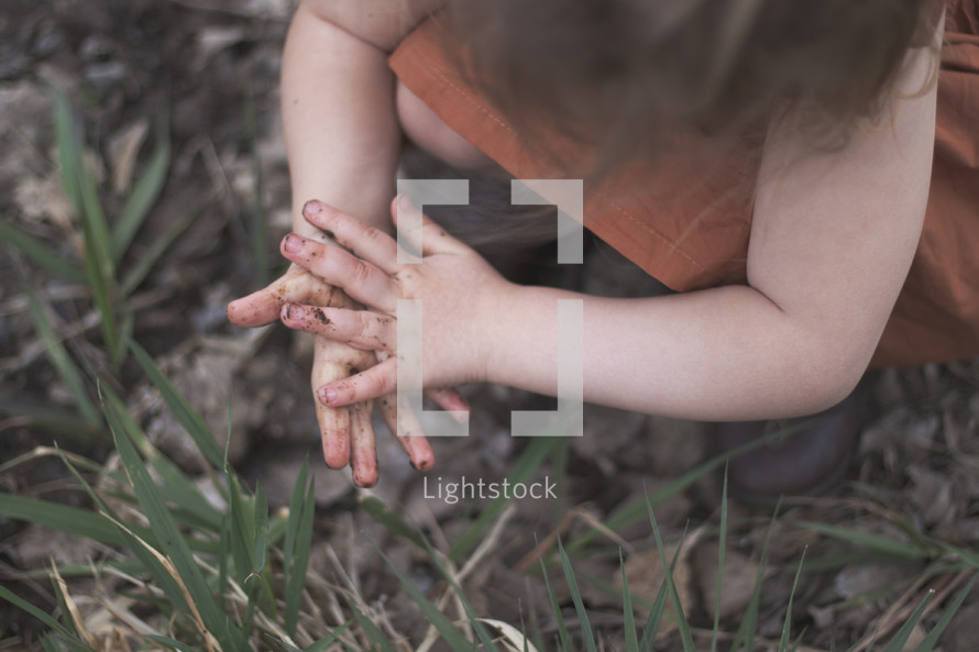 toddler with dirty hands