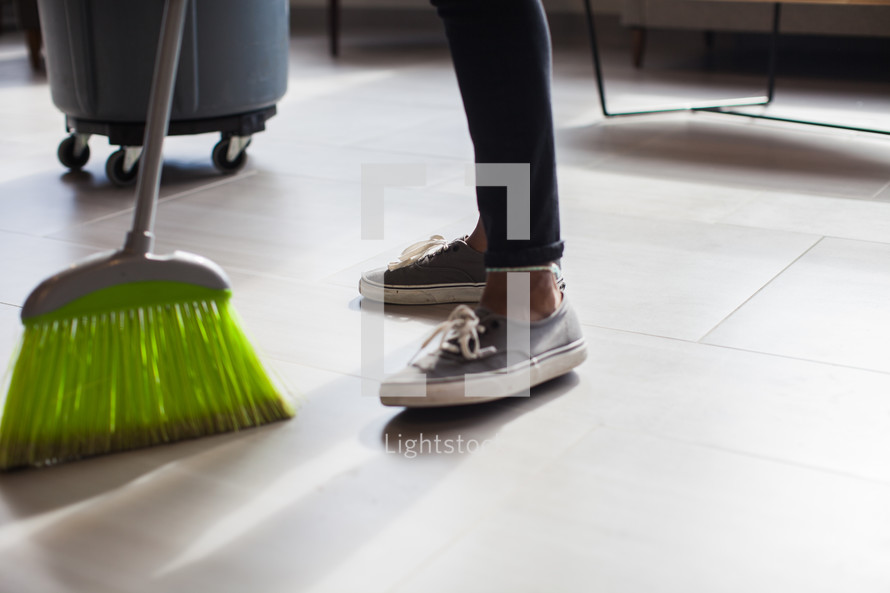 woman with a broom sweeping