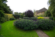 floral gardens and stone pathways