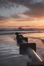concrete pipe on a beach