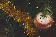 ornaments on a decorated Christmas tree