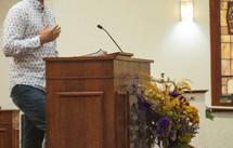 preacher at a pulpit
