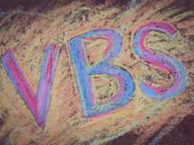 VBS written in colorful chalk.