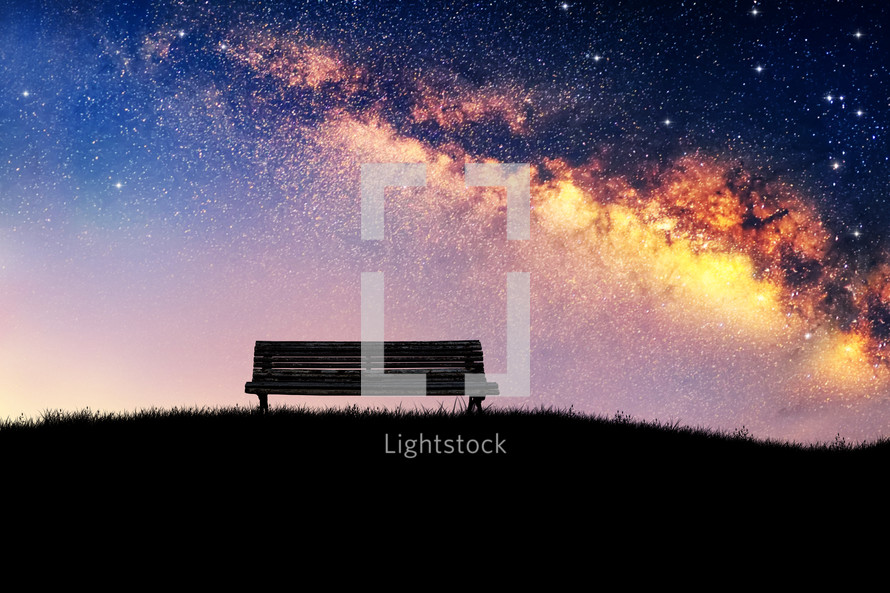 empty bench under the universe