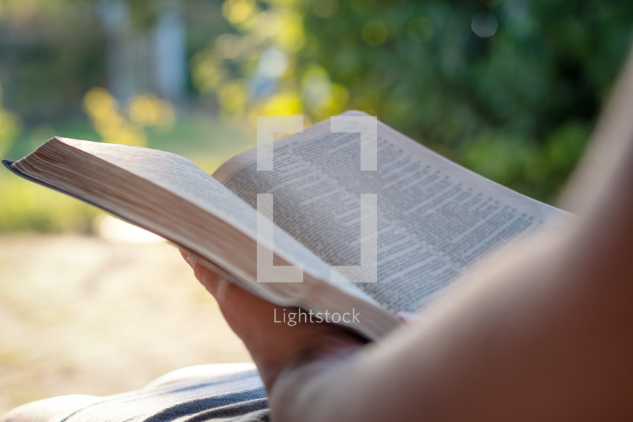 a person reading a Bible