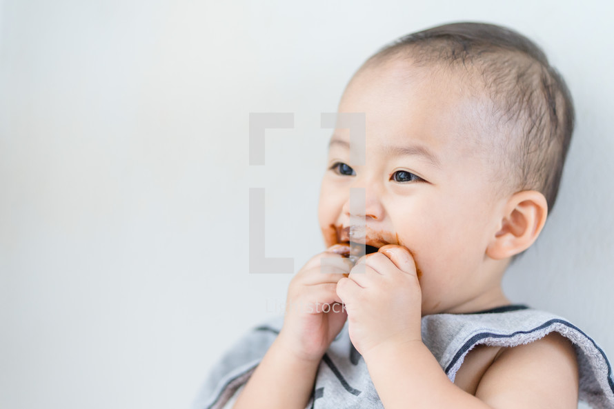 infant with a messy face