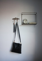 keys and purse hanging on a hook
