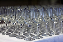 Empty wine glasses_ lined up on table