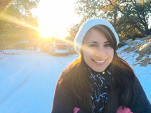 face of a smiling woman in the snow