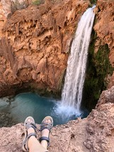 sandals and a view of a waterfall