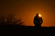 silhouette of a man in a hoodie