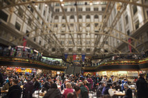 people eating in a crowded food court