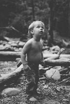 toddler boy exploring outdoors