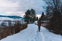 a woman walking through the snow