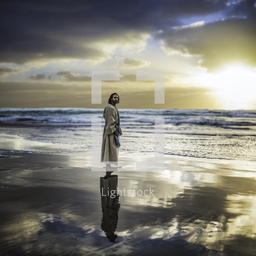 Jesus walking along a shore
