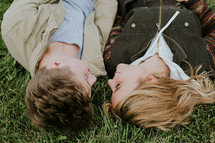 a couple lying in grass