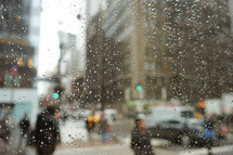 water droplets on a window and view of a city