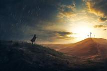 three cross on a hilltop