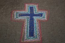 colorful rainbow cross in sidewalk chalk