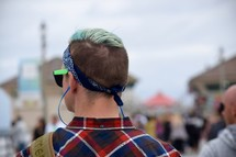 a young man with blue hair stylish trendy haircut