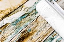 blueprints on weathered wood